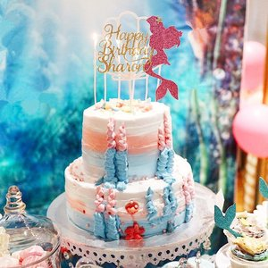 Close up pic of the decadent 2 tier strawberry flavoured 'Enchanted Underwater' theme cake from @sapphiretouch and the beautiful #mermaid topper from @polliepapeterie. Love the taste of the cake- not too sweet and there's that tinge of strawberry taste. So yummy! @sapphiretouch paid alot of attention to the design of the cake I wanted and she even went the extra mile to buy seashells and starfishes mold because she didn't have it. Got to give it to her! 👍🏻 She also drew up a sketch and showed me how the finished seashell and starfish looks like. She takes her work very seriously and making sure I was happy with the design. 👍🏻👍🏻👍🏻😊 For the topper from @polliepapeterie, I showed them roughly what I wanted and they did 2 sketches for me to choose. Effort!! The topper is glittery in real life and it's so pretty. It's my second time working together with them. Previously they did the intricate wedding logo topper for my anniversary cake last year.  You can tell when someone has deep passion in their work when you communicate with them. I'm glad to say both of them have so much to offer and they're talented in their own ways. Communication was a breeze as well. I'm saying this not because this is sponsored, but they are my heartfelt words. Thank you both!  Do follow them on their instagram to check out their works. #sharonsbirthdayparty #mermaidcake #mermaidtheme #sapphiretouch #polliepapeterie #sp #sofitelsentosa