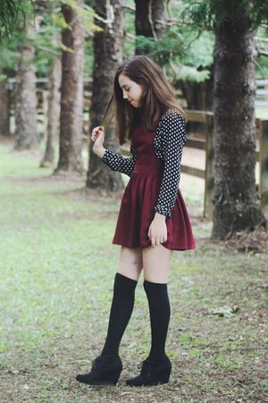 burgundy overall with polkadot shirt