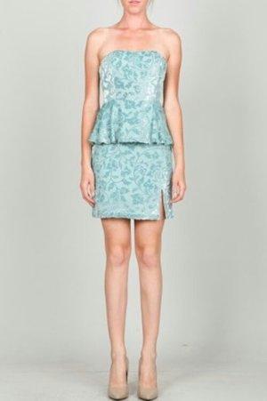 blue peplum top with color matching short skirt
