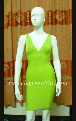 A sleeveless silhouette and sensual V-shaped back make this bandage dress a bold option for any evening occasion. V-neck. Sleeveless. V-shaped back. Center back zipper with hook-and-eye closure. To maintain the beauty of your garment, please follow the care instructions on the attached label. Rayon, Nylon, Spandex. Imported. Tags: Bandage Dresses, Cheap V-Neck Sleeveless Dresses