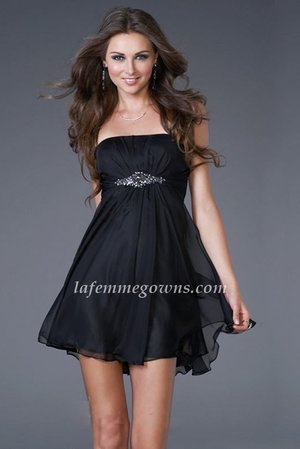 This design discount proves that a baby doll dress can have sex appeal. This strapless dress features a straight-cut neckline and moderate back. A cluster of jewels on the bodice accentuates the empire waist, and the sheer layers of the thigh-high skirt drift softly to the hemline. Give your look a glamorous edge when you wear this trendy little dress.  Size: Standard Size or Custom Made Size Closure: Side Zipper Details: Sheer Overlay, Sparkling Beadwork, Cups Fabric: Chiffon Length: Mini Length Neckline: Straight,Strapless Waistline: Empire Color: Black Tag: Black, Mini Length, Strapless, Chiffon, A-Line, Homecoming Dress
