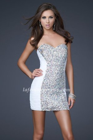 Looking for a short, simple but sparkly little mini!? This short is made of Net material that forms to a woman's shape! This dress is made of White, White, White, White, White or White! The sweetheart neckline is subtle, yet still trendy and retro! The entire busy and bodice in the center of this dress is made of clear iridescent shaped rhinestones to sparkle and shine in the light! The sides of this short dress for homecoming are rushed and layered to perfection to smooth out any unwanted lines!   Size: Standard Size or Custom Made Size Closure: Side Zipper Details: Ruched, Covered in AB Jewels Fabric: Stretch Mesh, AB Jewels Length: Short Neckline: Strapless Sweetheart  Waistline: Natural Color: White Tag: White, Short, Strapless, Homecoming Dresses, La Femme 16368