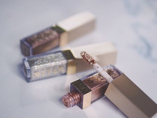 "<div class=""photoCaption"">It's Stila Written in the Stars Glitter and Glow Liquid Eyeshadow Set, part of Holiday Collection. All three shades are universal, and versatile to pair with any makeup looks and all of them are so gorgeous. They can be worn by themselves or layered eyeshadow as glitter top coats. @stilacosmetics ✨✨<br /> _<br /> _<br /> Swipe for details<br /> _<br /> _<br />  <a class=""pink-url"" target=""_blank"" href=""http://m.clozette.co.id/search/query?term=clozetteid&siteseach=Submit"">#clozetteid</a>  <a class=""pink-url"" target=""_blank"" href=""http://m.clozette.co.id/search/query?term=clozettedaily&siteseach=Submit"">#clozettedaily</a>  <a class=""pink-url"" target=""_blank"" href=""http://m.clozette.co.id/search/query?term=femaledaily&siteseach=Submit"">#femaledaily</a>  <a class=""pink-url"" target=""_blank"" href=""http://m.clozette.co.id/search/query?term=beautytips&siteseach=Submit"">#beautytips</a>  <a class=""pink-url"" target=""_blank"" href=""http://m.clozette.co.id/search/query?term=makeuptips&siteseach=Submit"">#makeuptips</a>  <a class=""pink-url"" target=""_blank"" href=""http://m.clozette.co.id/search/query?term=makeupjunkie&siteseach=Submit"">#makeupjunkie</a>  <a class=""pink-url"" target=""_blank"" href=""http://m.clozette.co.id/search/query?term=instamakeup&siteseach=Submit"">#instamakeup</a>  <a class=""pink-url"" target=""_blank"" href=""http://m.clozette.co.id/search/query?term=makeupflatlay&siteseach=Submit"">#makeupflatlay</a>  <a class=""pink-url"" target=""_blank"" href=""http://m.clozette.co.id/search/query?term=makeupinfo&siteseach=Submit"">#makeupinfo</a>  <a class=""pink-url"" target=""_blank"" href=""http://m.clozette.co.id/search/query?term=beautyblogger&siteseach=Submit"">#beautyblogger</a>  <a class=""pink-url"" target=""_blank"" href=""http://m.clozette.co.id/search/query?term=beautyblog&siteseach=Submit"">#beautyblog</a>  <a class=""pink-url"" target=""_blank"" href=""http://m.clozette.co.id/search/query?term=stilawritteninthestars&siteseach=Submit"">#stilawritteninthestars</a>  <a class=""pink-url"" target=""_blank"" href=""http://m.clozette.co.id/search/query?term=stilaliquideyeshadow&siteseach=Submit"">#stilaliquideyeshadow</a>  <a class=""pink-url"" target=""_blank"" href=""http://m.clozette.co.id/search/query?term=kittenkarma&siteseach=Submit"">#kittenkarma</a>  <a class=""pink-url"" target=""_blank"" href=""http://m.clozette.co.id/search/query?term=diamonddust&siteseach=Submit"">#diamonddust</a>  <a class=""pink-url"" target=""_blank"" href=""http://m.clozette.co.id/search/query?term=makeuplover&siteseach=Submit"">#makeuplover</a></div>"