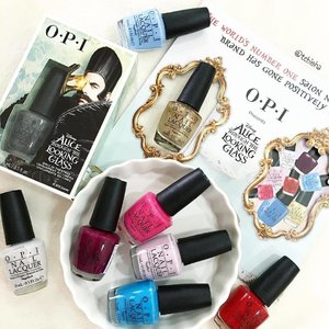 """Join in the recent Alice in the Wonderland Craze! 🐇 ♠️♣️♥️♦️ #OPI has launched the Disney Alice Through The Looking Glass Collection. 8 insanely gorgeous shades and special edition shade """"What time isn't it"""" in matte black with slivers of sliver (not available in Watsons) 🔸The nail lacquers retail at $16 each. 🔹The Disney Alice Through The Looking Glass Collection also features the Alice and Mad Hatter Duo Packs which includes 2 nail lacquers (Fearlessly Alice & A Mirror Escape + What's the Hatter with You? & Mad for Madness Sake respectively). The duo packs retail at $26 each. The collection is now available at selected @watsonssg stores, departmental stores and top OPI salons. #opisgxdisneyalice #opisg #nailpolish #notd #nailart #beauty #clozette Thanks #CotySg for sending gorgeous collection over! 😘"""