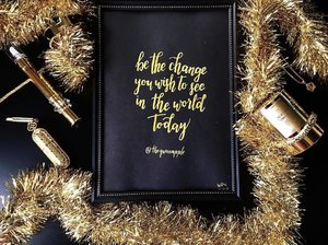 """• • • C A L L I G R A P H Y • • •  Received a a very beautiful piece of calligraphy print from @vyny_crafts, with my favourite quote; """"Be the change that you wish to see in the world today"""" in gold letterings. . Prints are not only in trend now, for me it is also good in a way to wake up & remind myself to start the day with positive vibes! Plus, this customised print also jazz up my vanity table with an elegant touch. . Customisation is not an issue, as you can see, i have requested for my IG handle to be included after the quote. And if there is any special requests, always feel free to send an email to victoriayny@gmail.com . Handwritten pieces are always exquisite, romantic and personal. Perfect as gifts for all occasions, or anytime when you want to send positive vibes to someone! . Visit http://vynycrafts.com for a fine selection of customised prints, notebooks (prices start from SGD $9.90) & for updates on their events! They promise to only deliver good things! <SP> . #sponsoredpost #sp #sgcalligraphy #handmade #customisation #sgprints #supportlocalbrands #art #artistic"""