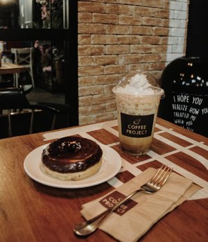 "Sometimes you just need to enjoy your own company. Having a ""me-date"" with my fave choco donut and vanilla iced coffee👯(nahhh joke I'm with my brother haha) 