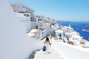 Wearing white to Santorini may be great but would have preferred a different color to make myself pop out of these stone-washed walls! Glad I had this blue floppy hat with me! It's made in the Philippines!!