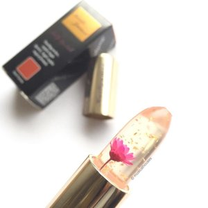The prettiest #lipstick I've seen in awhile! @kailijumei Flame Red - it's got a little #flower and #gold flakes embedded inside it! The lipstick also undergoes a cool #colorchange from clear to pink when applied! #Clozette #beauty #makeup