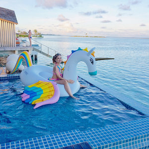 R A I N B O W 🌈 F L O A T Y ;  Riding on my Prince Floaty! He's so charming that even our neighbour from the villa-next-door filmed us on his video camera for quite a while too! 🎥 (see page 2) P.S. : Floaty is a Pegasus, not Unicorn. 😁 . . . #maldives #summer #finolhu #clubmed #clubmedmaldives #clubmedfinolhu #beach #beachwear #swimwear #rainbow #clozette #horizon #skyscape #inifinitypool