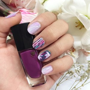 """I name this """"Urban Escapade"""". Lancôme Vernis in Love Midnight Rose is a deep rich true violet, representing the power and complexity of our urban world 🏢 I balanced it with pastels and summery florals to illustrate my desire to escape to a dreamy world beyond those fluffy clouds to fulfill my wanderlust ☁️✈️ What's your idea of an escape from the city's hustle and bustle? #clozette #getklarity #beauty"""