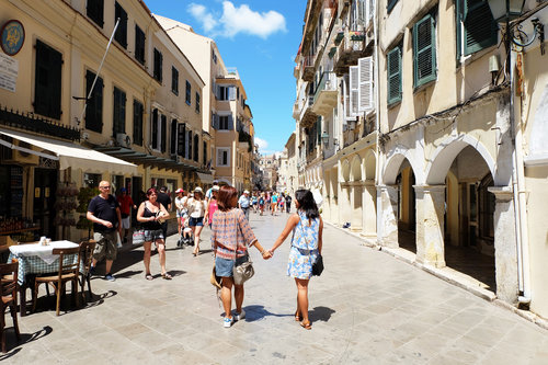 """<div class=""""photoCaption"""">Walking around Corfu with my mom! I love travelling and going out on an adventure with her company</div>"""