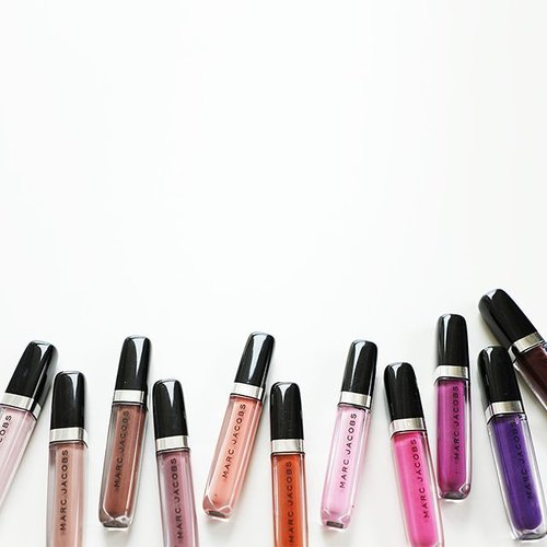 """<div class=""""photoCaption"""">Move over matte lipsticks — brighter and better lip glosses are here! We were able to get our hands on the Marc Jacobs Beauty Enamored Hi-Shine Lip Lacquer Lip Gloss and if you're intrigued by the shades, just head over to #ClozetteINSIDER (clozette.co/insider) to watch our swatch vid!</div>"""