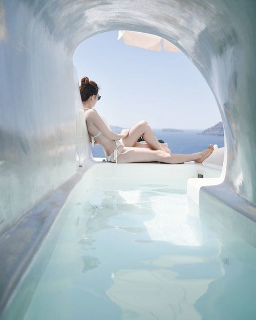 """<div class=""""photoCaption"""">Blog updated on this gorgeous #lavacave and the almost impossible way to get there. And no, don't laugh at my tan lines.. 📷: @tyrelllam #instahusband #greece #travel #santorini#oia #cavepool#clozette</div>"""