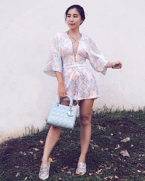"""<div class=""""photoCaption"""">Printed matters by @rentadress_sg  Featuring Ophelia Cross Playsuit, get 15% off min $50 rentals using the code <SODAPOPP15></div>"""