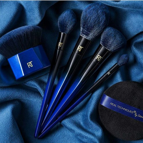 """<div class=""""photoCaption"""">Hot new picks: Can we take a moment to just admire this beautiful set of brushes?  Inspired by Blue Squirrels, Real Techniques is all set to launch a PowderBleu Makeup Brushe line. This 6 piece brush collection (to be sold separately)will launch in July. Look out for cult favourites such as the classic setting and kabuki brushes along with some eye-catching picks like the Soft Finishing Brush. The Navy blue and black colour tones are just 😍. I've adored @realtechniques as a brand for years and I'm excited for the launch. . . . #realtechniques #beautyjunkie #clozette #makeupaddict #makeupslaves #slave2beauty #makeupjunkie #makeupobsessed #makeupfanatic1 #beautyblogger #makeupgoals #hudabeauty #sgmakeup #makeupbloggers #sgbeauty #sgigbeauty #desi #wakeupandmakeup #sgmua #makeupmess #beautytalk #beautyful #makeupbrushes</div>"""