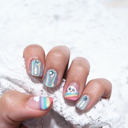 """<div class=""""photoCaption"""">@TwentyNailsSg gave me shiny holographic nails with stars (reflecting rainbow light) and matching rainbow nails! 🌈Super cute and super me don't ya think? 😆#TwentyNailsSg is having their GSS promotion now! 💕- Classic Mani + Pedi $46.80 (U.P. $76)- Classic Gel Mani + Classic Pedi $60.80 (U.P. $98)- Classic Gel Mani + Pedi $73.80 (U.P. $120)Includes foot bath of your choice! 👣#clozette #rainbownail #rainbownailart #rainbowsarecool #rainbowsareawesome #holographicnailpolish #holographicpolish</div>"""