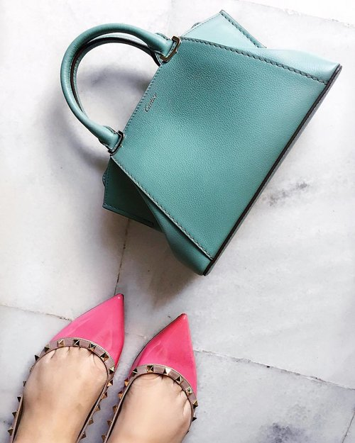 """<div class=""""photoCaption"""">This post is for those of you who DM-ed me to ask for a closer look at my Mini C de Cartier bag. And for the others who asked about the colour, it's the limited edition colour, Beryl Green . . . . . . .  #shoefie #shoegasm #whenfeetmeetfloors #valentinoaddicted #shoegram  #luxuryblogger #detailsoftheday #fromwhereistand #myunicornlife #thatsdarling #minicdecartier #rockstuds #acolorstory #instaluxury  #luxuryfashion #luxurylifestyle  #luxuryblogger #stylediaries #stylefile #luxuryblog  #bagsoftpf #purseboppicks #fwis #marblefloor #monochrome  #pursuepretty #streetstyleluxe #boptalk #ootdwatch #ihavethisthingwithfloors</div>"""