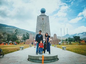 Family picture in between Northern and Southern hemispheres, Equator Line.#ecuador #equator #familypicture #clozetteid
