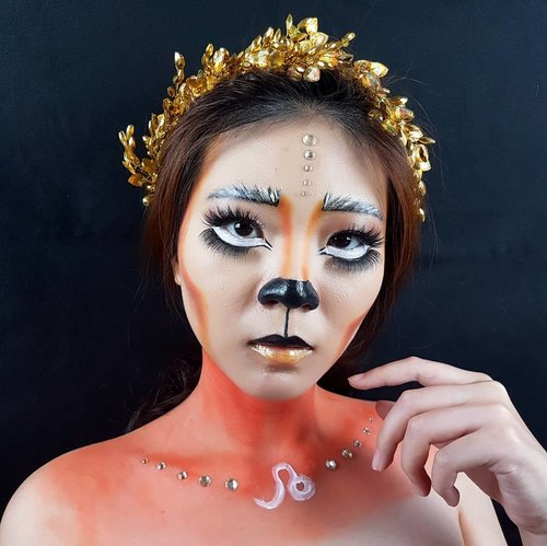 "<div class=""photoCaption"">Leo mana nih suara nya??? Banyak banget yang request buat bikin Makeup Look Zodiac Leo ini.. So here is it 🧡<br /> .<br /> Selanjut nya kalian mau zodiac apa lagi??<br /> .<br /> Product details:<br /> @nyxcosmetics_indonesia Total Drop Control Foundation<br /> @maybelline Master Conceal Concealer<br /> @riveracosmetics Luminous Micro Powder<br /> @makeoverid Two Way Cake Powder<br /> @blpbeauty Dual Eye Liner<br /> @nyxcosmetics_indonesia Eyeshadow Palette In your element Fire<br /> Upper Lashes @lashesbyjanuary_ <br /> Under Lashes @silverswanlash<br /> @lorealindonesia @getthelookid lipstick<br /> Facepainting Imagic Palette<br /> .<br /> Hairpiece @nissolashop<br /> .<br /> .<br /> .<br /> .<br />  <a class=""pink-url"" target=""_blank"" href=""http://m.clozette.co.id/search/query?term=zodiacmakeup&siteseach=Submit"">#zodiacmakeup</a>  <a class=""pink-url"" target=""_blank"" href=""http://m.clozette.co.id/search/query?term=horoscopemakeup&siteseach=Submit"">#horoscopemakeup</a>  <a class=""pink-url"" target=""_blank"" href=""http://m.clozette.co.id/search/query?term=leomakeup&siteseach=Submit"">#leomakeup</a>  <a class=""pink-url"" target=""_blank"" href=""http://m.clozette.co.id/search/query?term=zodiacinspiration&siteseach=Submit"">#zodiacinspiration</a>  <a class=""pink-url"" target=""_blank"" href=""http://m.clozette.co.id/search/query?term=facechart&siteseach=Submit"">#facechart</a>  <a class=""pink-url"" target=""_blank"" href=""http://m.clozette.co.id/search/query?term=artsymakeup&siteseach=Submit"">#artsymakeup</a>  <a class=""pink-url"" target=""_blank"" href=""http://m.clozette.co.id/search/query?term=mnyitlook&siteseach=Submit"">#mnyitlook</a><br />  <a class=""pink-url"" target=""_blank"" href=""http://m.clozette.co.id/search/query?term=luellamakeup&siteseach=Submit"">#luellamakeup</a>  <a class=""pink-url"" target=""_blank"" href=""http://m.clozette.co.id/search/query?term=tampilcantik&siteseach=Submit"">#tampilcantik</a>  <a class=""pink-url"" target=""_blank"" href=""http://m.clozette.co.id/search/query?term=indobeautygram&siteseach=Submit"">#indobeautygram</a>  <a class=""pink-url"" target=""_blank"" href=""http://m.clozette.co.id/search/query?term=bvloggerid&siteseach=Submit"">#bvloggerid</a>  <a class=""pink-url"" target=""_blank"" href=""http://m.clozette.co.id/search/query?term=cchannelbeautyid&siteseach=Submit"">#cchannelbeautyid</a>  <a class=""pink-url"" target=""_blank"" href=""http://m.clozette.co.id/search/query?term=beautiesquad&siteseach=Submit"">#beautiesquad</a>  <a class=""pink-url"" target=""_blank"" href=""http://m.clozette.co.id/search/query?term=clozetteid&siteseach=Submit"">#clozetteid</a>  <a class=""pink-url"" target=""_blank"" href=""http://m.clozette.co.id/search/query?term=clozzetebeauty&siteseach=Submit"">#clozzetebeauty</a>  <a class=""pink-url"" target=""_blank"" href=""http://m.clozette.co.id/search/query?term=bloggerindonesia&siteseach=Submit"">#bloggerindonesia</a>   <a class=""pink-url"" target=""_blank"" href=""http://m.clozette.co.id/search/query?term=beautilosophy&siteseach=Submit"">#beautilosophy</a>   <a class=""pink-url"" target=""_blank"" href=""http://m.clozette.co.id/search/query?term=indobeautysquad&siteseach=Submit"">#indobeautysquad</a>  <a class=""pink-url"" target=""_blank"" href=""http://m.clozette.co.id/search/query?term=beautygoersid&siteseach=Submit"">#beautygoersid</a>   <a class=""pink-url"" target=""_blank"" href=""http://m.clozette.co.id/search/query?term=beautybloggerindonesia&siteseach=Submit"">#beautybloggerindonesia</a>  <a class=""pink-url"" target=""_blank"" href=""http://m.clozette.co.id/search/query?term=ragamkecantikan&siteseach=Submit"">#ragamkecantikan</a>   <a class=""pink-url"" target=""_blank"" href=""http://m.clozette.co.id/search/query?term=beautybloggerbandung&siteseach=Submit"">#beautybloggerbandung</a>  <a class=""pink-url"" target=""_blank"" href=""http://m.clozette.co.id/search/query?term=setterspace&siteseach=Submit"">#setterspace</a>  <a class=""pink-url"" target=""_blank"" href=""http://m.clozette.co.id/search/query?term=bloggerbandung&siteseach=Submit"">#bloggerbandung</a>  <a class=""pink-url"" target=""_blank"" href=""http://m.clozette.co.id/search/query?term=muatribeid&siteseach=Submit"">#muatribeid</a>  <a class=""pink-url"" target=""_blank"" href=""http://m.clozette.co.id/search/query?term=kbbvmember&siteseach=Submit"">#kbbvmember</a>  <a class=""pink-url"" target=""_blank"" href=""http://m.clozette.co.id/search/query?term=bloggermafia&siteseach=Submit"">#bloggermafia</a>  <a class=""pink-url"" target=""_blank"" href=""http://m.clozette.co.id/search/query?term=bunnyneedsmakeup&siteseach=Submit"">#bunnyneedsmakeup</a></div>"