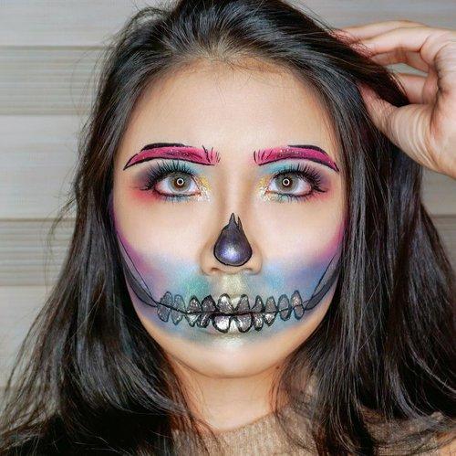 "<div class=""photoCaption"">❤️🧡💚Rainbow Pop Art Skull Halloween Makeup Look💚💙💛<br /> .<br /> Makeup Details:<br /> - @jeffreestar @jeffreestarcosmetics Beauty Killer Eyeshadow Palette & @klaracosmetics_id @klaracosmetics in Malibu.<br /> - @wardahbeauty EyeXpert Optimum Hi-Black Liner<br /> - @superfacestudio stardust holographic shadow<br /> - @kaycollection Kay Lash in Girl Next Door 26mm<br /> - Softlense: @x2softlens Na Azul<br /> .<br /> Inspired by: @jessiepaege .<br /> .<br />  <a class=""pink-url"" target=""_blank"" href=""http://m.clozette.co.id/search/query?term=clozetteid&siteseach=Submit"">#clozetteid</a>  <a class=""pink-url"" target=""_blank"" href=""http://m.clozette.co.id/search/query?term=eyemakeup&siteseach=Submit"">#eyemakeup</a>  <a class=""pink-url"" target=""_blank"" href=""http://m.clozette.co.id/search/query?term=halloweenmakeup&siteseach=Submit"">#halloweenmakeup</a>  <a class=""pink-url"" target=""_blank"" href=""http://m.clozette.co.id/search/query?term=halloween&siteseach=Submit"">#halloween</a>  <a class=""pink-url"" target=""_blank"" href=""http://m.clozette.co.id/search/query?term=eye&siteseach=Submit"">#eye</a>  <a class=""pink-url"" target=""_blank"" href=""http://m.clozette.co.id/search/query?term=instamakeup&siteseach=Submit"">#instamakeup</a>  <a class=""pink-url"" target=""_blank"" href=""http://m.clozette.co.id/search/query?term=makeup&siteseach=Submit"">#makeup</a>  <a class=""pink-url"" target=""_blank"" href=""http://m.clozette.co.id/search/query?term=eyes&siteseach=Submit"">#eyes</a>  <a class=""pink-url"" target=""_blank"" href=""http://m.clozette.co.id/search/query?term=eyesmakeup&siteseach=Submit"">#eyesmakeup</a>  <a class=""pink-url"" target=""_blank"" href=""http://m.clozette.co.id/search/query?term=color&siteseach=Submit"">#color</a>  <a class=""pink-url"" target=""_blank"" href=""http://m.clozette.co.id/search/query?term=colorful&siteseach=Submit"">#colorful</a>  <a class=""pink-url"" target=""_blank"" href=""http://m.clozette.co.id/search/query?term=colorfulmakeup&siteseach=Submit"">#colo"