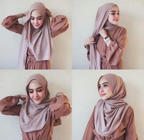 "<div class=""photoCaption"">Tutorial hijab ala Hamidah :D</div>"