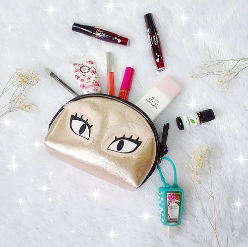 """<div class=""""photoCaption"""">What's in my makeup pouch?*@altheakorea Petal Velvet Sunaway so that my skin is always protected against harmful UV rays.*Various lippies (at least 3 and the variant changes daily 🤣).*Eyeliner just in case i need a touch up.*Hand cream because dry hands are the worst.*Peppermint essential oil for a quick perk-me-up.*Hand sanitizer so i can always be germ free 😁😁😁. You can clearly see that i'm a huge Korean beauty fan since 70% of my pouch's contents are Korean brands! <a class=""""pink-url"""" target=""""_blank"""" href=""""http://m.clozette.co.id/search/query?term=altheakorea&siteseach=Submit"""">#altheakorea</a>  <a class=""""pink-url"""" target=""""_blank"""" href=""""http://m.clozette.co.id/search/query?term=altheasunaway&siteseach=Submit"""">#altheasunaway</a>  <a class=""""pink-url"""" target=""""_blank"""" href=""""http://m.clozette.co.id/search/query?term=petalvelvetsunaway&siteseach=Submit"""">#petalvelvetsunaway</a>  <a class=""""pink-url"""" target=""""_blank"""" href=""""http://m.clozette.co.id/search/query?term=whatsinmypouch&siteseach=Submit"""">#whatsinmypouch</a>  <a class=""""pink-url"""" target=""""_blank"""" href=""""http://m.clozette.co.id/search/query?term=sunawaygiveaway&siteseach=Submit"""">#sunawaygiveaway</a>  <a class=""""pink-url"""" target=""""_blank"""" href=""""http://m.clozette.co.id/search/query?term=altheakorea&siteseach=Submit"""">#altheakorea</a>  <a class=""""pink-url"""" target=""""_blank"""" href=""""http://m.clozette.co.id/search/query?term=altheaangels&siteseach=Submit"""">#altheaangels</a>  <a class=""""pink-url"""" target=""""_blank"""" href=""""http://m.clozette.co.id/search/query?term=AltheaIndonesia&siteseach=Submit"""">#AltheaIndonesia</a>  <a class=""""pink-url"""" target=""""_blank"""" href=""""http://m.clozette.co.id/search/query?term=clozetteid&siteseach=Submit"""">#clozetteid</a> <a class=""""pink-url"""" target=""""_blank"""" href=""""http://m.clozette.co.id/search/query?term=sbybeautyblogger&siteseach=Submit"""">#sbybeautyblogger</a> <a class=""""pink-url"""" target=""""_blank"""" href=""""http://m.clozette.co.id/search/query?term=bloggerindonesia&siteseach=Submit"""">#bloggerindone"""