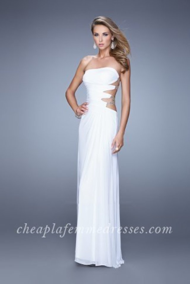 4da032dfe20 This awesome evening gown features a strapless and straight neckline. Cutout  sides with beaded sheer and ruched fabric winds across the back